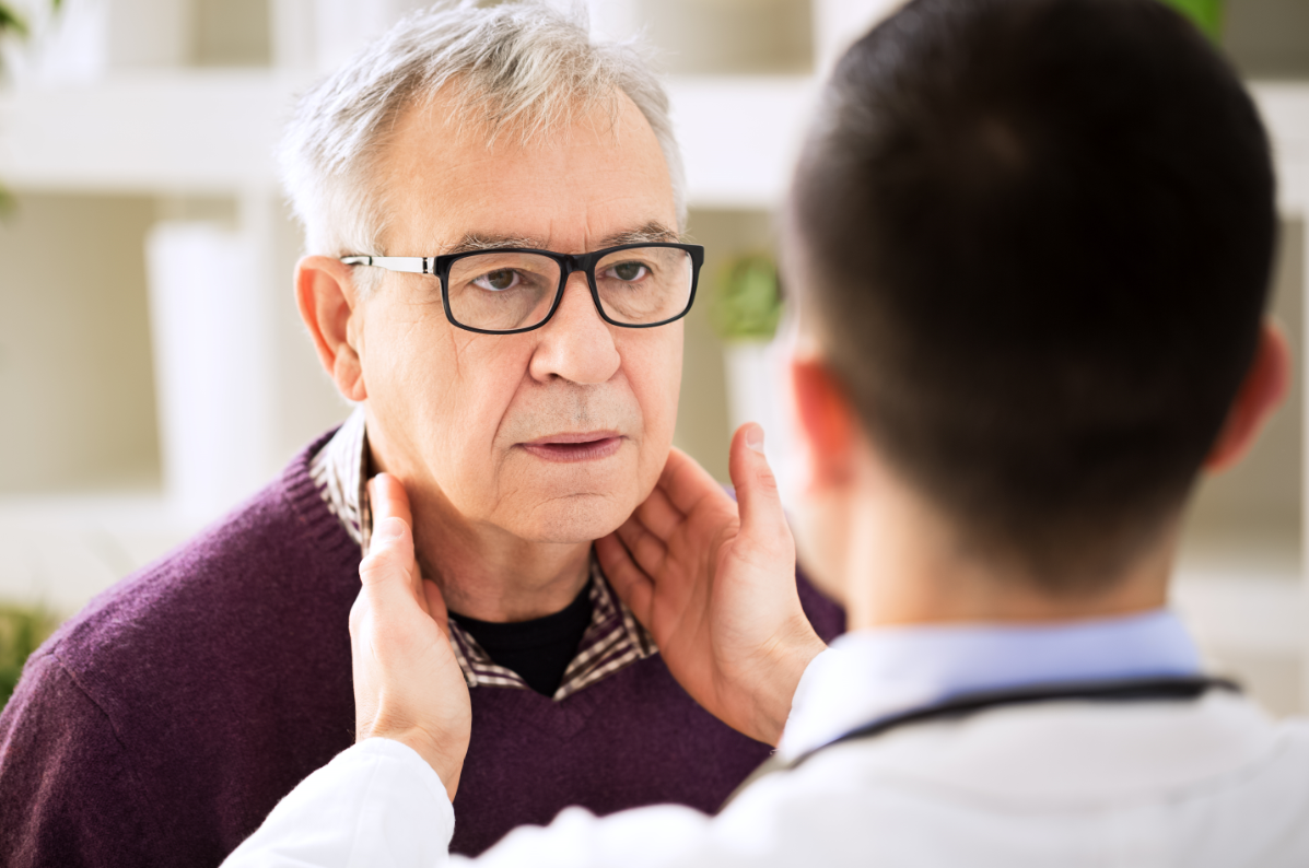 senior being checked for flu symptoms by a doctor