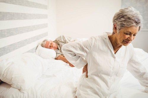 older woman having trouble sleeping
